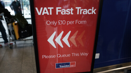Image display VAT fast-track sign in an airport